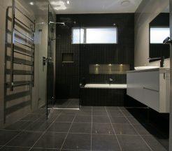 Sydney Bathroom Renovators - Black Bathroom With Flooring Tiles