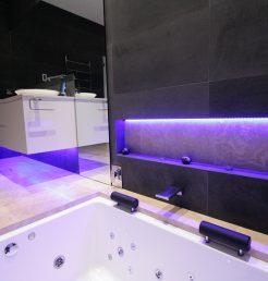 Sydney Bathroom Renovators - Black tile bathroom with light under sink cabinet