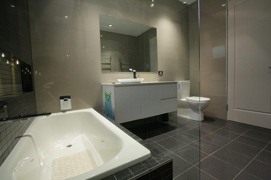 Sydney Bathroom Renovators - dark bathroom with black ...