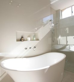 Sydney Bathroom Renovators - Small white and round bathtub in corner