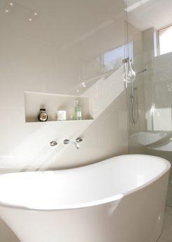 Sydney Bathroom Renovators - Small white and round bathtub in corner