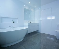 Sydney Bathroom Renovators - bathroom with grey flooring tiles and white walls - view on bathtub