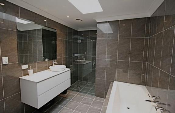 Sydney Bathroom Renovators - bathroom with brown tiles