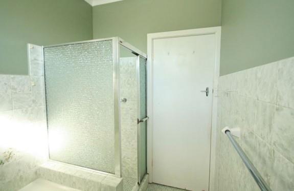 Sydney Bathroom Renovators - light green bathroom with corner shower and glass door