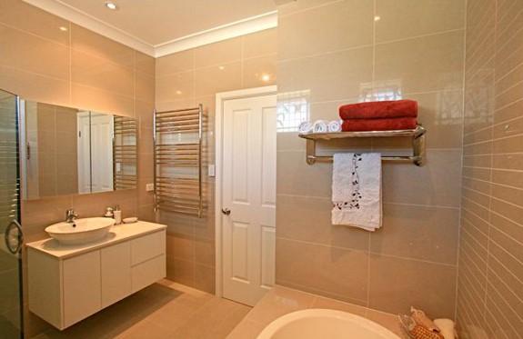 Sydney Bathroom Renovators - bathroom with beige wall tiles