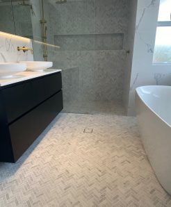 Herringbone and Marble Tile Elegant Bathroom Renovations Sutherland Shire