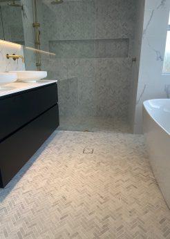 Herringbone and Marble Tile Elegant Bathroom Renovations Sutherland Shire